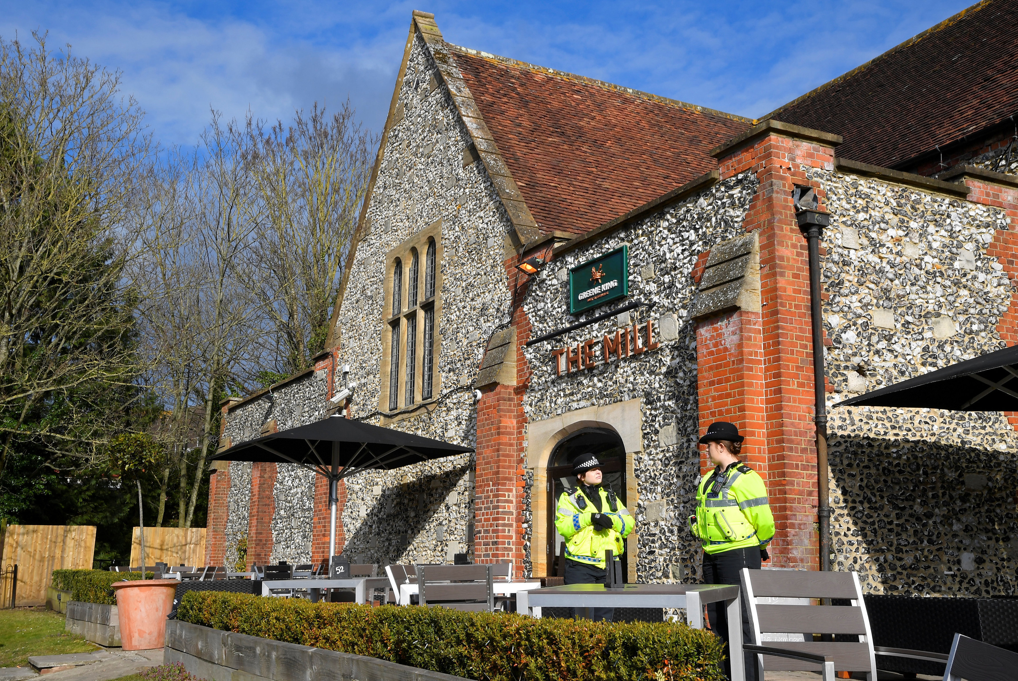 Police officers stand outside a pub near to where former Russian inteligence officer Sergei Skripal, and his daughter Yulia were found unconscious after they had been exposed to an unknown substance, in Salisbury, Britain, March 7, 2018