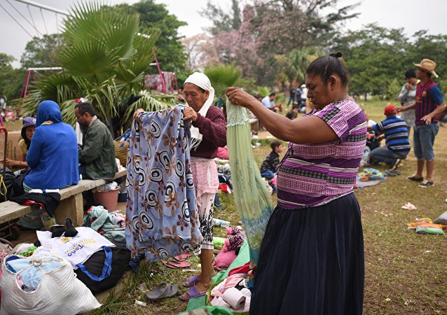 Central American migrants taking part in the Migrant Via Crucis caravan towards the United States pack their belongings as they prepare to leave a sport complex where they were camping in Matias Romero, Oaxaca State, Mexico