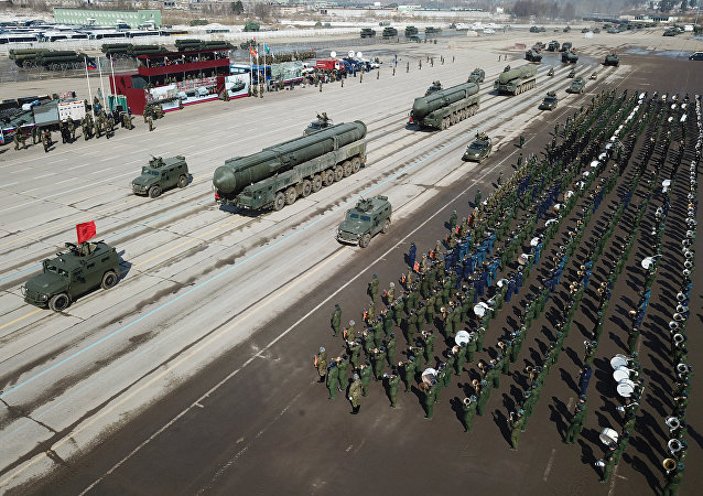 Tigr armored vehicles with Arbalet remote controlled weapon stations and RS-24 Yars transporter-launcher containers during a Victory Day Military Parade rehearsal at the Alabino military training ground in the Moscow Region