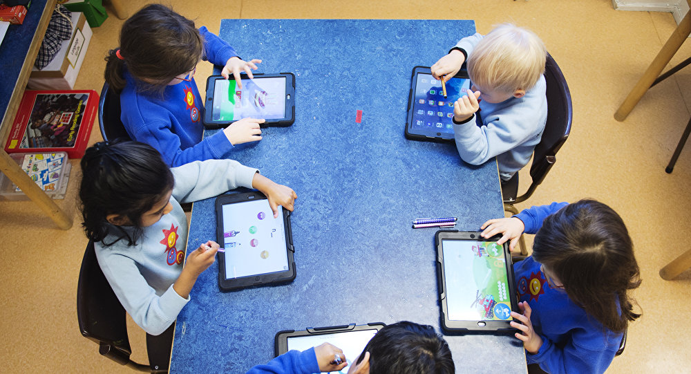 Nursery school pupils work with iPads (photo used for illustration purpose)