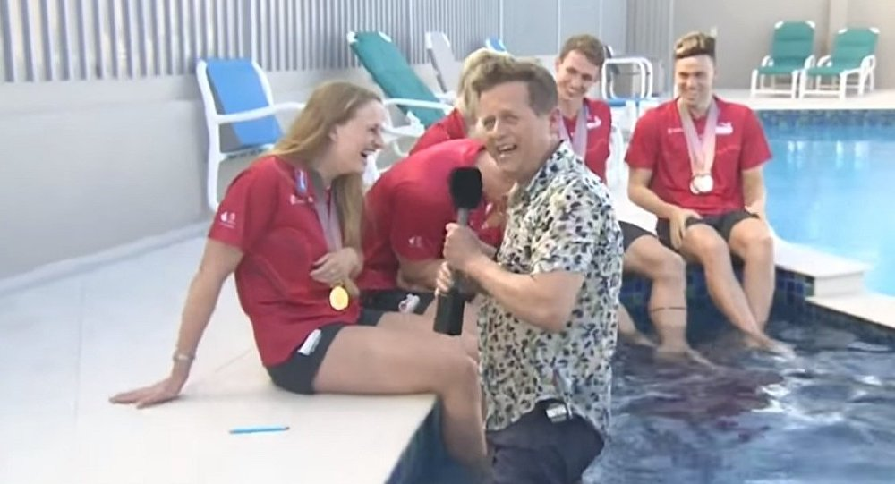 Reporter hilariously falls into pool on live TV