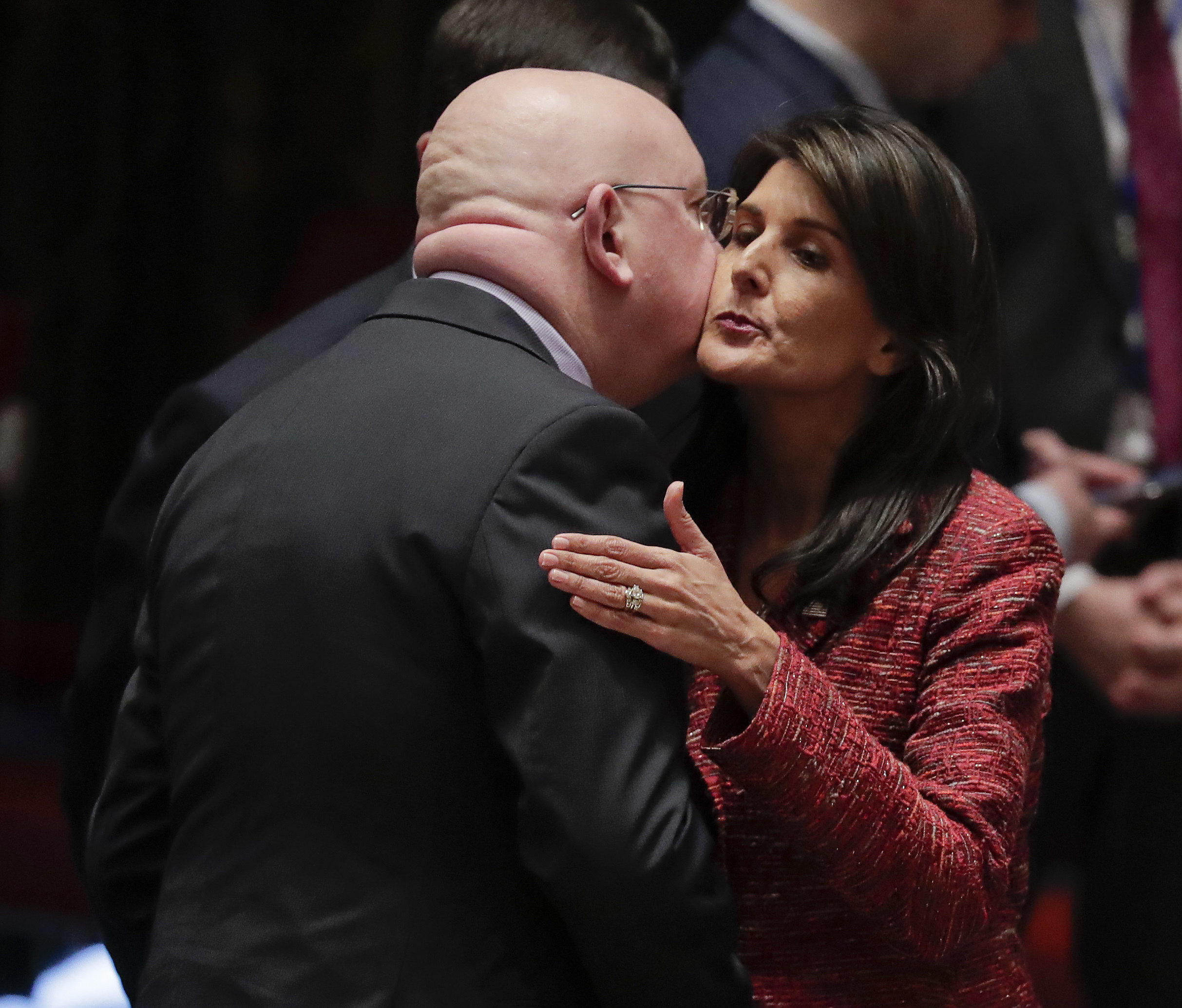 Russian Ambassador to the United Nations Vasily Nebenzya, left, and United States Ambassador to the U.N. Nikki Haley exchange greetings before a Security Council meeting, Tuesday, April 10, 2018, at U.N. headquarters