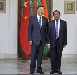 Indian National Security Adviser Ajit Doval, right, poses with Chinese State Councillor Yang Jiechi for photos before their meeting in New Delhi, India. (File)
