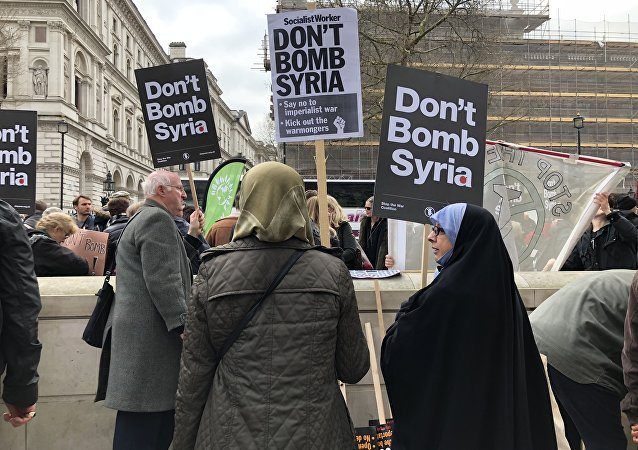Crowds in London protest against Britain and the US launching military strikes in Syria