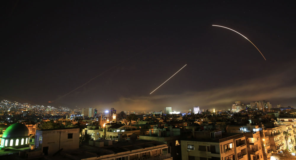 Missiles streak across the Damascus skyline as the U.S. launches an attack on Syria targeting different parts of the capital, early Saturday, April 14, 2018