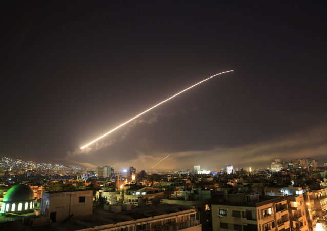 The Damascus sky lights up missile fire as the US launches an attack on Syria targeting different parts of the capital early Saturday, April 14, 2018