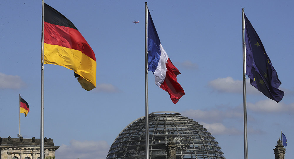 The French, center, the German, left, and the EU flag, right, fly in front of the German parliament (File)