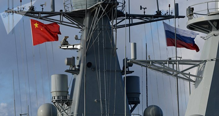 State flags of Russia and China are flown on destroyer Shijiazhuang during the Russian-Chinese exercise Naval Interaction 2017