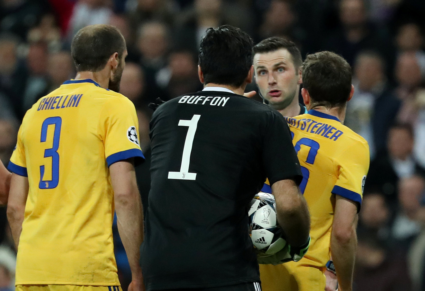 Juventus' Gianluigi Buffon remonstrates with referee Michael Oliver after being sent off. File photo