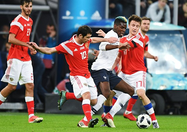 From left, first plan: Alan Dzagoyev (Russia), Paul Pogba (France) and Alexander Golovin (Russia) during the friendly match between Russia and France