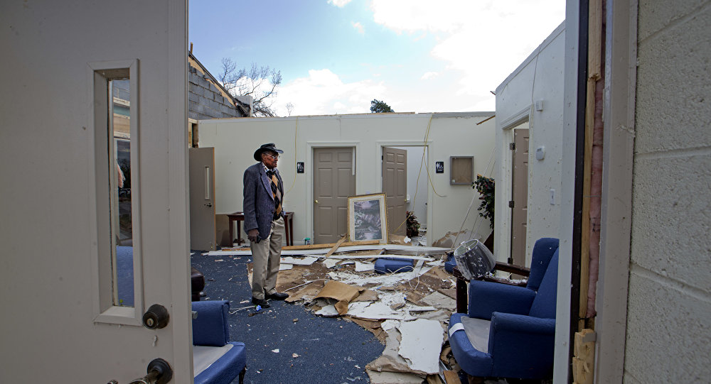 Pastor Lester Woodard surveys the damage inside Living Hope Missionary Baptist Church, Monday, April 16, 2018, in Greensboro, N.C. Sunday's tornado destroyed most of the roof and furniture in the church.