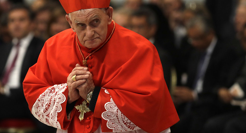 New cardinal Ernest Troshani Simoni, presbyter of the archdiocese of Shkoder-Pult, leaves after receiving the red three-cornered biretta hat during a consistory inside the St. Peter's Basilica at the Vatican, Saturday, Nov. 19, 2016