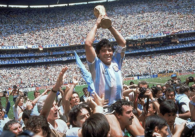 Diego Maradona of Argentina celebrates with the cup at the end of the World Cup soccer final in the Atzeca Stadium, in Mexico City, Mexico. (File)