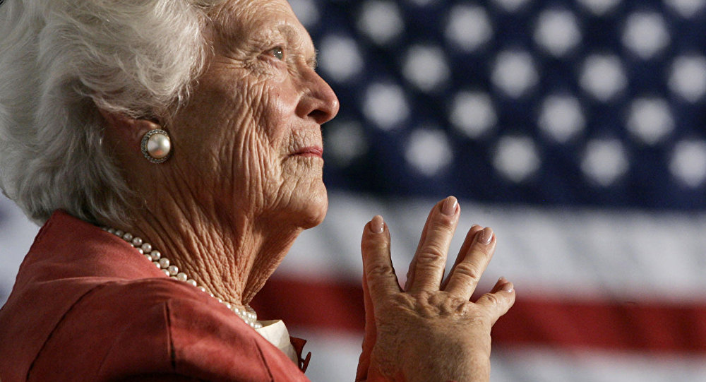 Former U.S. first lady Barbara Bush listens to her son, President George W. Bush, as he speaks at an event on social security reform in Orlando, Florida March 18, 2005