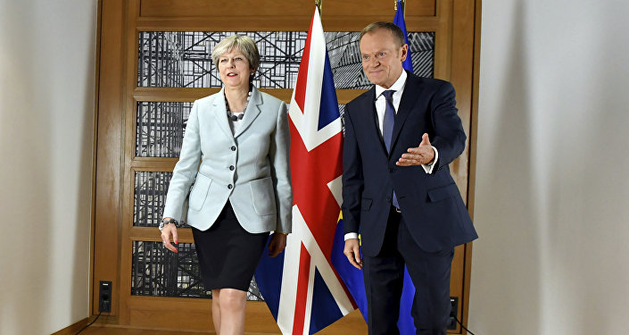 British Prime Minister Theresa May, left, walks with European Council President Donald Tusk prior to a meeting at the Europa building in Brussels on Friday, Dec. 8, 2017