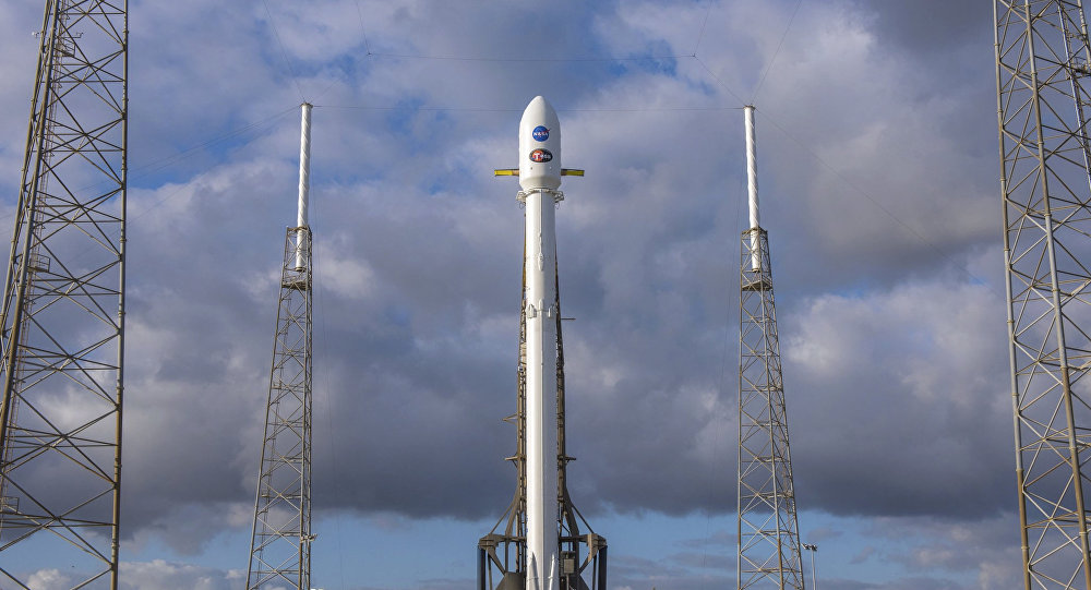 In this image released by SpaceX, NASA' s Transiting Exoplanet Survey Satellite (Tess) sits atop a SpaceX Falcon 9 rocket at Space Launch Complex 40, Monday, April 16, 2018, in Cape Canaveral, Fla.