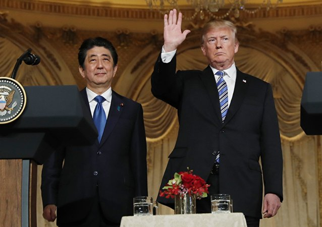 US President Donald Trump (R) waves at the conclusion of a joint press conference with Japan's Prime Minister Shinzo Abe at Trump's Mar-a-Lago estate in Palm Beach, Florida, U.S., April 18, 2018