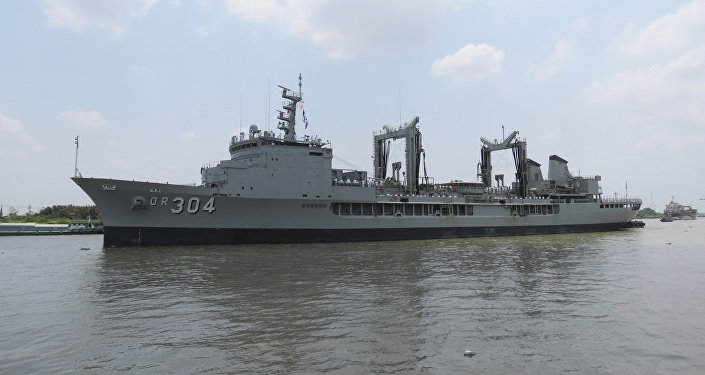 In this Thursday, April 19, 2018, photo, Royal Australian Navy frigate HMAS Success prepares to dock at Saigon port in Ho Chi Minh City, Vietnam