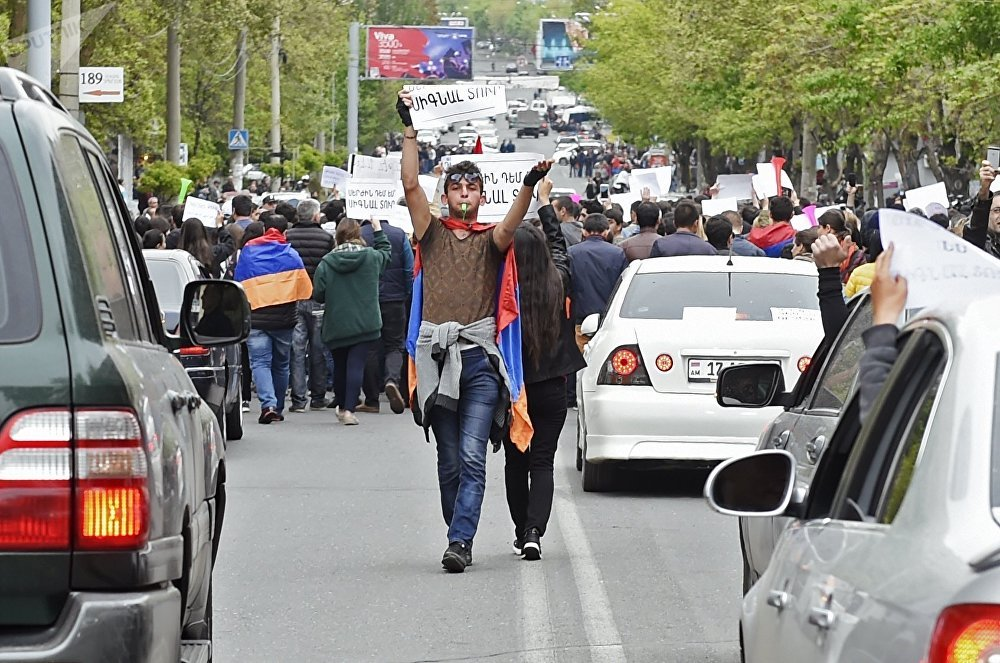 A participant in a protest rally against the election of former President Serzh Sargsyan as prime minister of Armenia in Yerevan