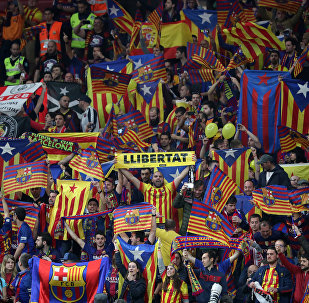 Soccer Football - Spanish King's Cup Final - FC Barcelona v Sevilla - Wanda Metropolitano, Madrid, Spain - April 21, 2018 Barcelona fan holds up a Llibertat banner before the match as Catalan and Catalan separatist flags are displayed