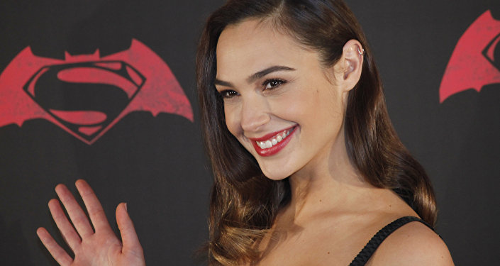 Israeli actress Gal Gadot poses for photos during a press conference to promote the movie: Batman v Superman: Dawn of Justice in which she plays the roles of super heroine Wonder Woman, and secret alter-ego Diana Prince, in Mexico City, Saturday, March 19, 2016