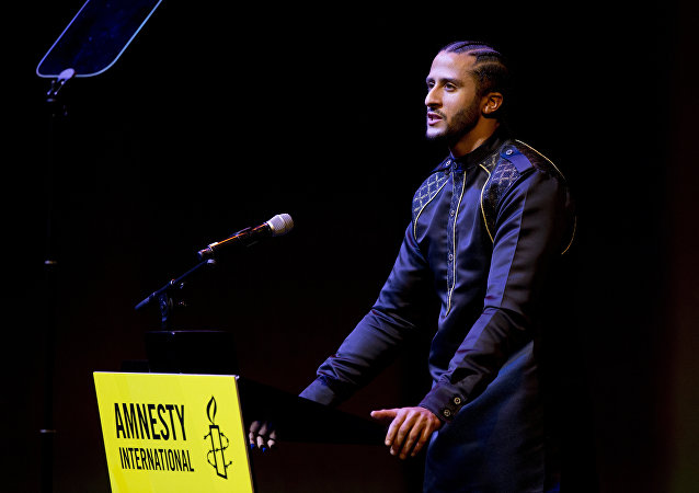 Former NFL quarterback and social justice activist Colin Kaepernick speaks after receiving the Amnesty International Ambassador of Conscience Award for 2018 in Amsterdam, Saturday April 21, 2018. Kaepernick became a controversial figure when refusing to stand for the national anthem, instead he knelt to protest racial inequality and police brutality.