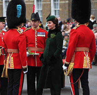 Britain's Kate, the Duchess of Cambridge, smiles as she and Prince William visit the 1st Battalion Irish Guards, for the St. Patrick's Day Parade, at Cavalry Barracks, in Hounslow, England, Saturday, March 17, 2018