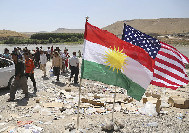 U.S. and Kurdish flags flutter in the wind (File)