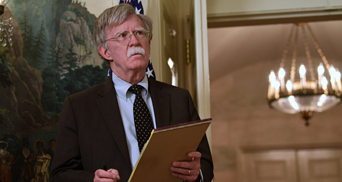 National security adviser John Bolton listens President Donald Trump speaks in the Diplomatic Reception Room of the White House on Friday, April 13, 2018, in Washington, about the United States' military response to Syria's chemical weapon attack on April 7