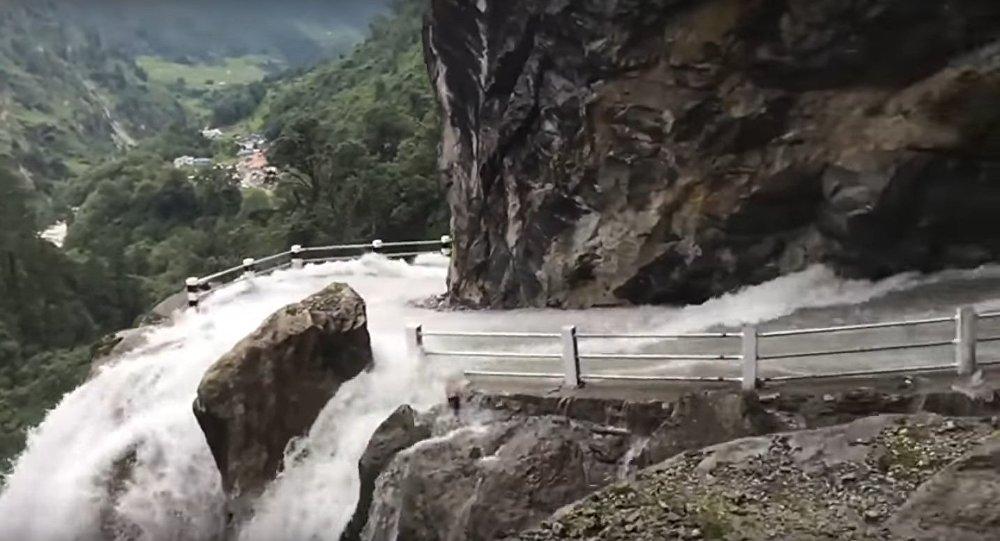 huge waterfall crashes through nepalese mountain road sputnik