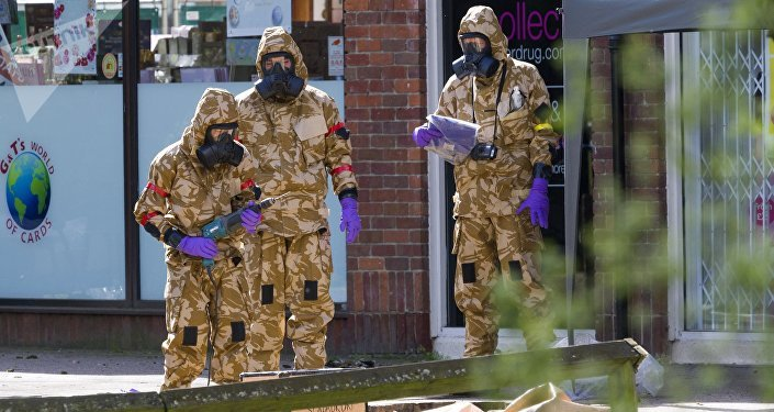 Military men cleaning the spots related to Skripal poisoning in Salisbury.