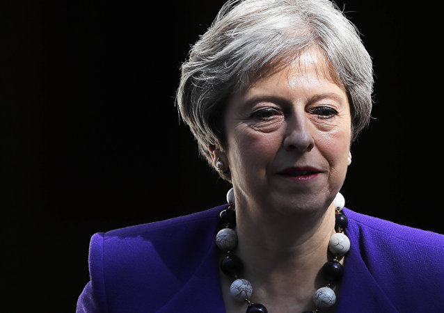 Britain's Prime Minister Theresa May leaves 10 Downing Street in central London on April 18, 2018, as she heads to the weekly Prime Minister's Questions (PMQs) session in the House of Commons.
