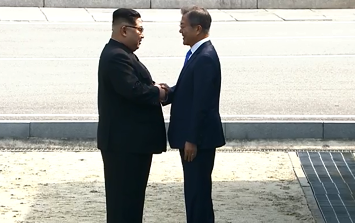 Kim Jong Un shakes hands with Moon Jae In during historic summit