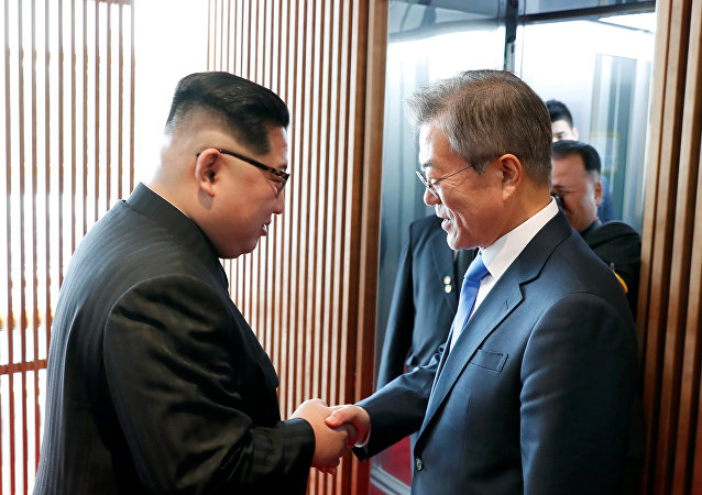 South Korean President Moon Jae-in shakes hands with North Korean leader Kim Jong Un at the truce village of Panmunjom inside the demilitarized zone separating the two Koreas, South Korea, April 27, 2018