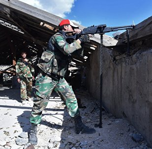 Soldiers near Palestinian refugee camp of Yarmouk in south Damascus