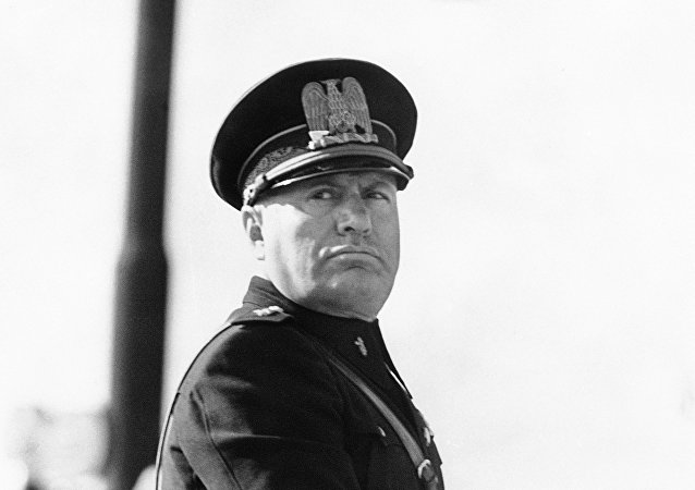 Benito Mussolini, in the newly introduced Fascist uniform, on his horse at a parade of police to commemorate the 13th anniversary of the foundation of the Metropolitan Police in Rome, Italy around Oct. 20, 1938