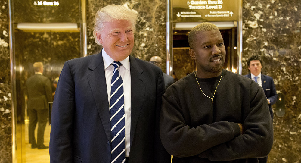 President-elect Donald Trump, left, and Kanye West pose for a picture in the lobby of Trump Tower in New York, Tuesday, Dec. 13, 2016