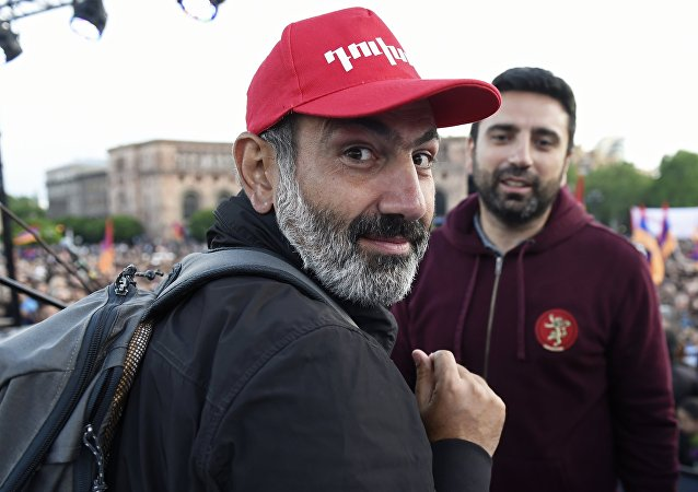 Leader of the My Step opposition movement Nikol Pashinyan, left, at a rally on Republic Square in Yerevan