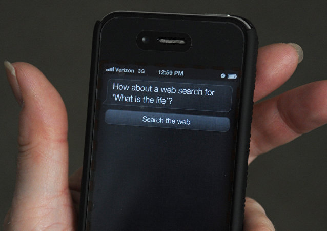 A woman tries to use Siri voice-activated assistant software built into the Apple iPhone 4S March 13, 2012 in Washington, DC. An iPhone 4S buyer has sued Apple for promising more than it delivered