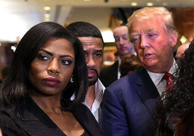 Omarosa Manigault (L) who was a contestant on the first season of Donald Trump's The Apprentice and is now an ordained minister, appears alongside Republican presidential hopeful Donald Trump during a press conference November 30, 2015