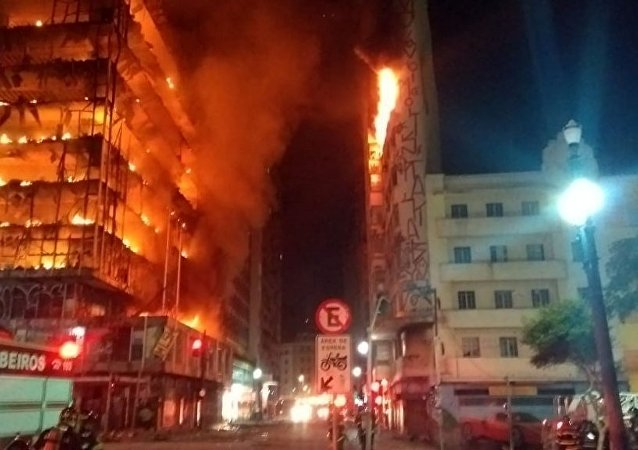 An enormous blaze has felled a building in Sao Paulo