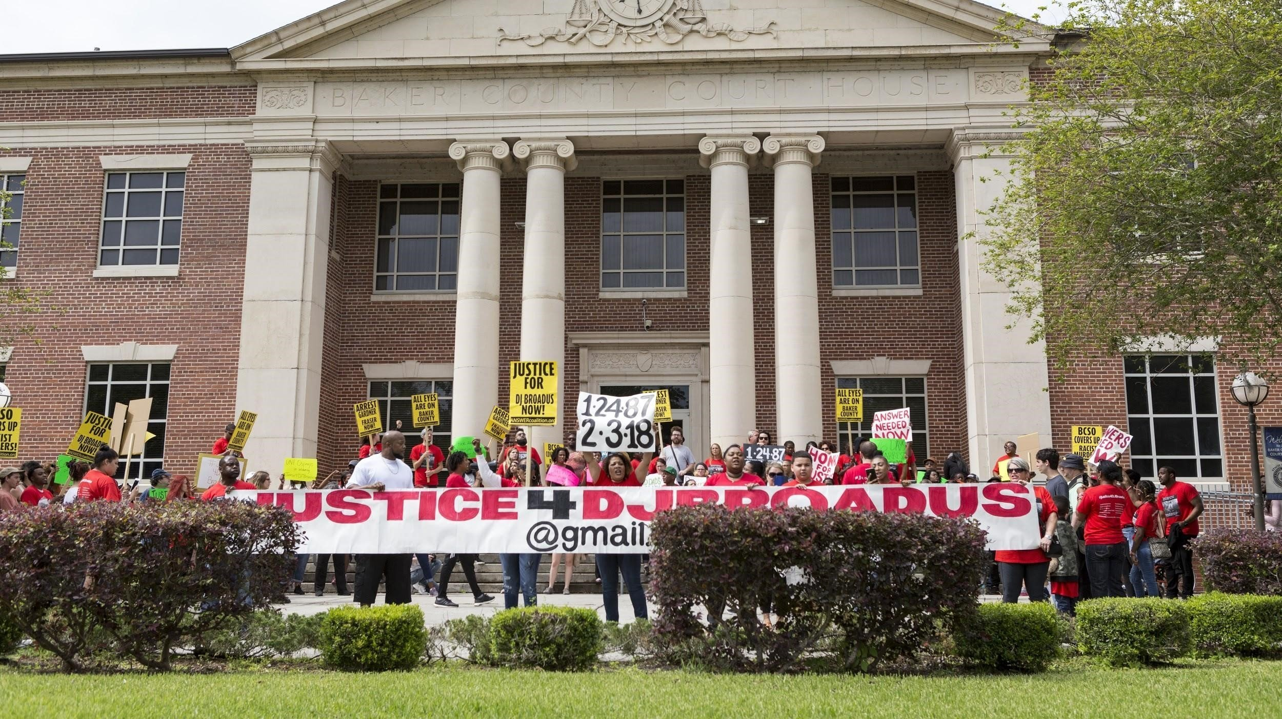 Community members gather in front of the Baker County Courthouse in Macclenny, Florida, to demand justice for DJ Broadus. photo credit Emil Ashok.