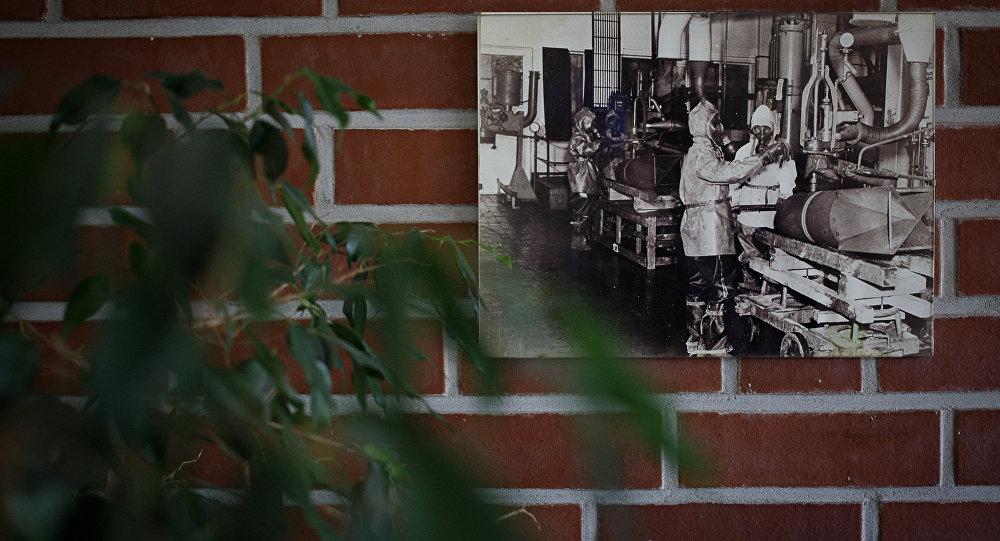 A historical photograph showing the dismantling of chemical weapons is seen during a demonstration in a chemical weapons destruction facility at GEKA (Gesellschaft zur Entsorgung von chemischen Kampfstoffen und Ruestungsaltlasten) in Munster, northern Germany, on October 30, 2013