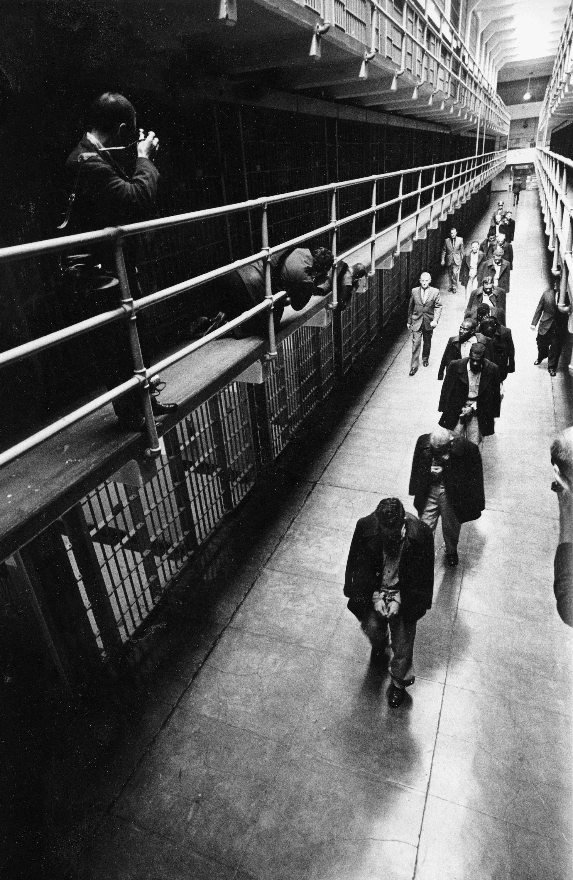 A line of handcuffed prisoners, walk through the cell block as they are transferred to other prisons from Alcatraz Island in San Francisco. (File)