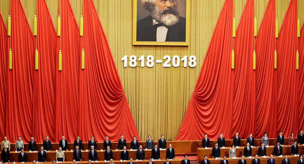 Chinese President Xi Jinping and other officials sing the national anthem at an event commemorating the 200th birth anniversary of Karl Marx, in Beijing, China May 4, 2018