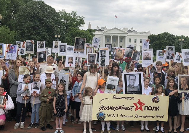 About 700 people walked from the White House to the WWII memorial during the Immortal Regiment March in Washington