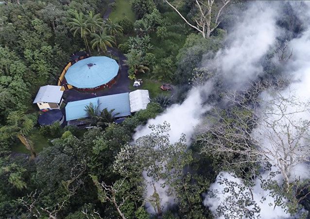 In this still frame taken from video, lava flows toward a home in the Puna District as a result of the eruption from Kilauea Volcano on Hawaii's Big Island, Friday, May 4, 2018