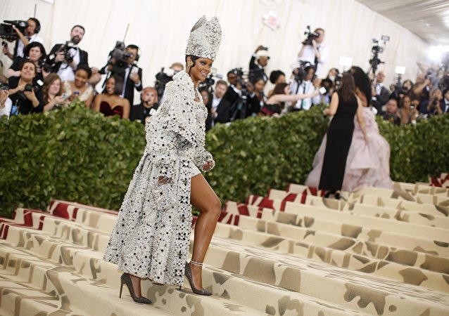 "Singer Rihanna arrives at the Metropolitan Museum of Art Costume Institute Gala (Met Gala) to celebrate the opening of ""Heavenly Bodies: Fashion and the Catholic Imagination"" in the Manhattan borough of New York, U.S., May 7, 2018"