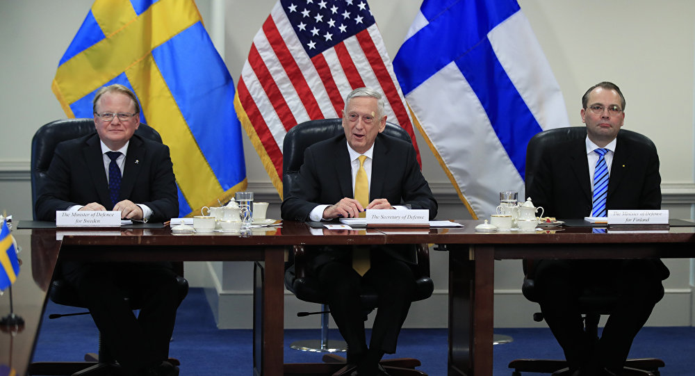 Secretary of Defense Jim Mattis, center, with Sweden's Minister of Defense Peter Hultqvist, left, and Finland's Minister of Defense Jussi Niinistö speaks during a trilateral meeting at the Pentagon, Tuesday, May 8, 2018