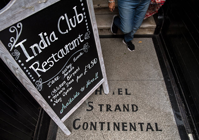 A blackboard stands at the entrance to the India Club restaurant in London on October 16, 2017